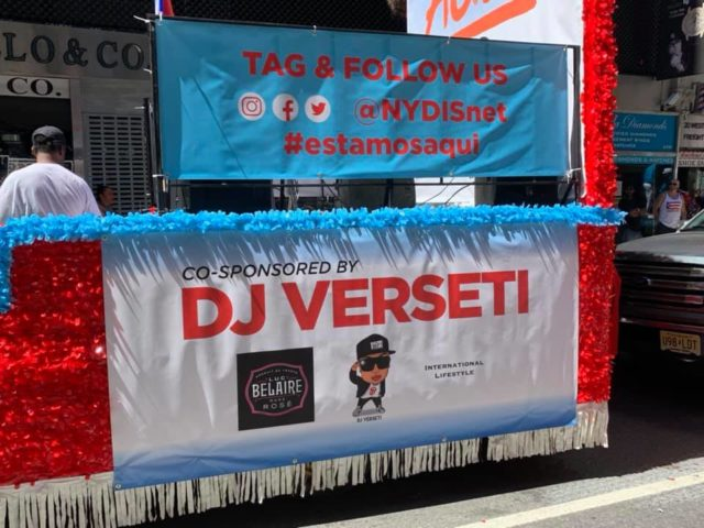 The Side of the NYDIS Float Complete with Social Media Handles and Co-Sponsorship Info on DJ Verseti