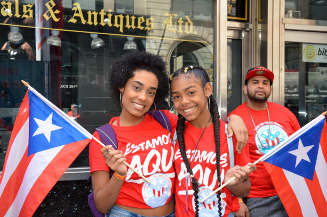 """Two Young Marchers Pose for a Photograph with their """"Estamos, Aquí"""" T-Shirts"""