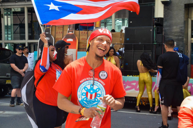 One Particularly Joyful Marcher Gears Up for the Parade to Start