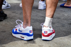 A Marcher Wears Festive Shoes with the Puerto Rican Flag Embroidered on the Back