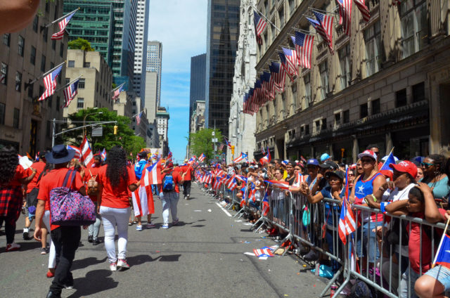 The Parade Route Lined with Supporters and their Flags