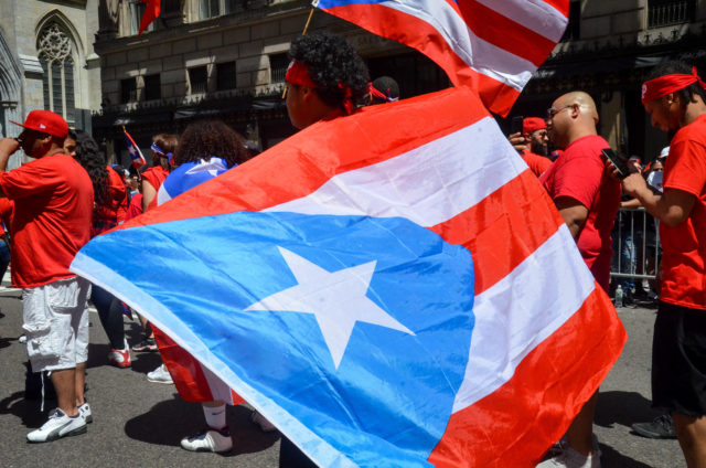 "One NYDIS Marcher Wrapped Himself in ""La Bandera Bonita"", The Beautiful Flag"